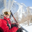 Woman sits at chair lift — Stock Photo #63368677