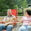 Couple is resting on balcony with cat — Stock Photo #64057823