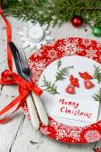 Christmas decoration for the table with red dish and cutlery — Stock Photo