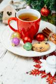 Christmas celebration tea time with cinnamon, cookie and baubles with Christmas tree background — ストック写真