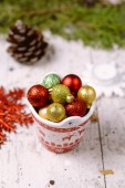 Porcelain bucket with colorful baubles for Christmas and New Yea — Stock Photo