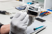 Close-up photos showing process of mobile phone repair — Stock Photo