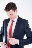 Young businessman dressing up — Stock Photo