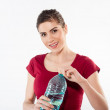 Beautiful close-up portrait of young woman with a bottle of water. — Stock Photo #78783016