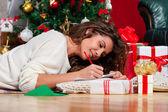 Writing a christmas card — Stock Photo