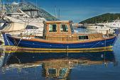 Wood boat on the water at the pier — Stock Photo