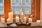 Candles and violin — Stock Photo