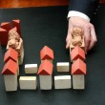 Man build wooden toy castle — Stock Photo #61873021