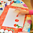 Child painting with fingers — Stock Photo #63128239