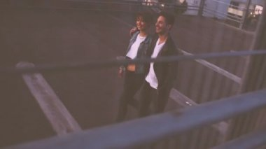 Couple Walking Together on Rooftop — Vídeo Stock