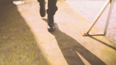 Man Walking in urban area wearing boots — Stock Video