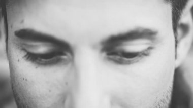 Close-up on young man's eyes — Vídeo Stock