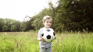 Little boy running with soccer ball — ストックビデオ