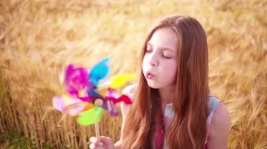 Young Girl Playing With Pinwheel — Stock Video