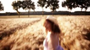 Girl Being Chased Through Wheat Field — Stock video