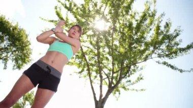 Woman in sportswear stretching — Video Stock
