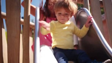 Mother and Son Go Down Slide — Stock Video