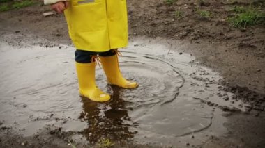 Young Child Jumping In Mud Puddle — Stock Video