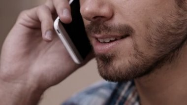 Man enjoying conversation on phone — Stock Video