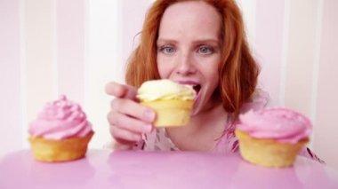 Beautiful woman with sweet cake — Stock Video