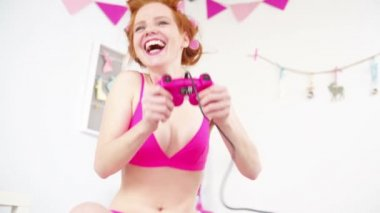 Red-haired girl playing video game — Stock Video
