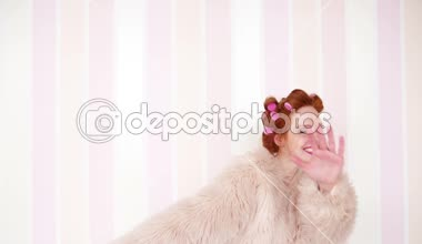 Red-haired girl in curlers dancing — Stock Video
