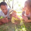 Parents with daughter eating ice creams — Stock Video #69856023