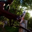 Athlete stretching his muscles at the roadside — Stock Video #69856269