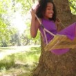Afro girl swinging playfully in park — Stock Video #69856917
