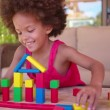 Afro girl playing with building blocks — Stock Video #69859009