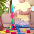 Children friends playing with building blocks — Stock Video #69859033
