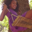 Afro girl swinging playfully in park — Stock Video #69859163