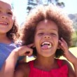 Little Afro girl with friends smiling — Stock Video #69859311