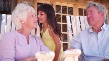 Little girl giving her grandmother a kiss — Stock Video