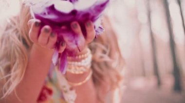 Boho girl blowing pink feathers — Stock Video
