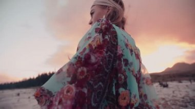 Boho girl dancing in floral dress — Stock Video