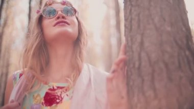 Boho girl with flower headband in a forest — Stock Video