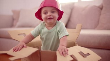 Baby boy plastic bowl on head — Stock Video