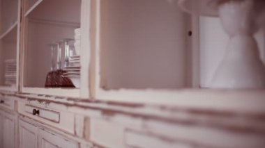 Dishware in kitchen cupboard — Stock Video