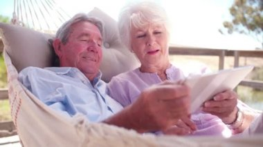 Senior couple using digital tablet — Stock Video