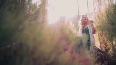 Boho girl surrounded by nature in springtime — Stock Video