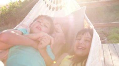 Mother and children together in a hammock — Stock Video