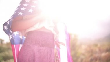 Girl with American flag in natural landscape — Stock Video