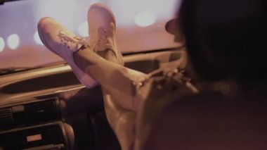 Girl in the passenger seat of a car at night — Stock Video