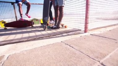 Longboarders feet and their skateboards — Stock Video