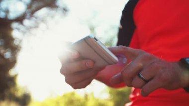 Mountain biker holding a smartphone — Wideo stockowe
