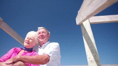 Senior couple enjoying retirement at the beach — Stock Video