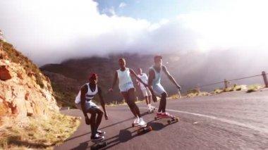 Skater pulling face on longboard — Stock Video