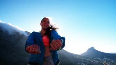 Teenage girl dancing in mountains — Stock Video