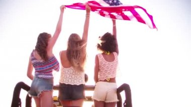 Girls happily flying an American flag — Stock Video